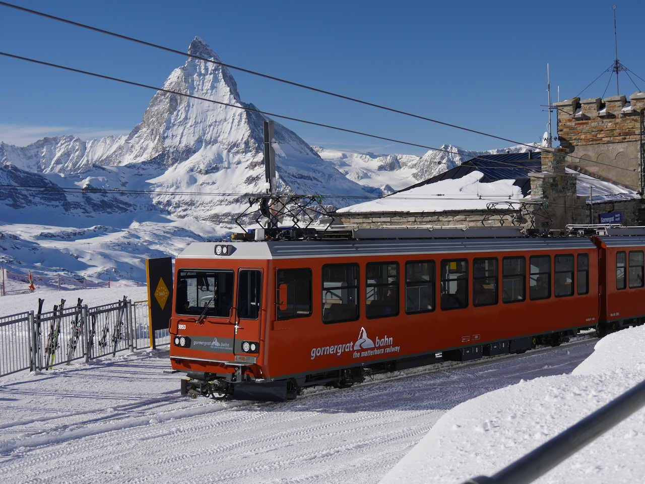 A traditional red coloured tram in Gornergrat in Zermatt