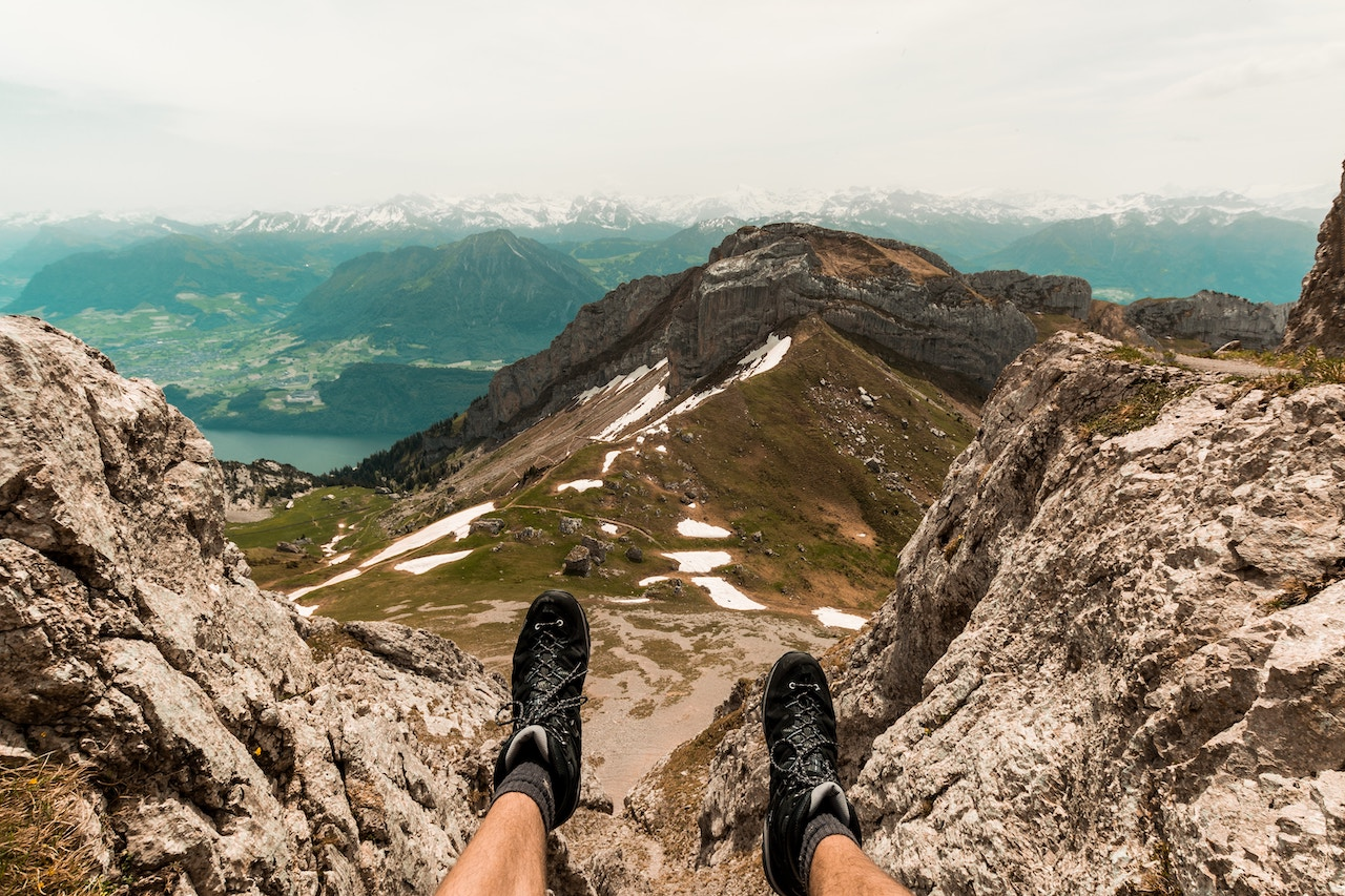 Hiker resting at the summit of Mount Pilatus
