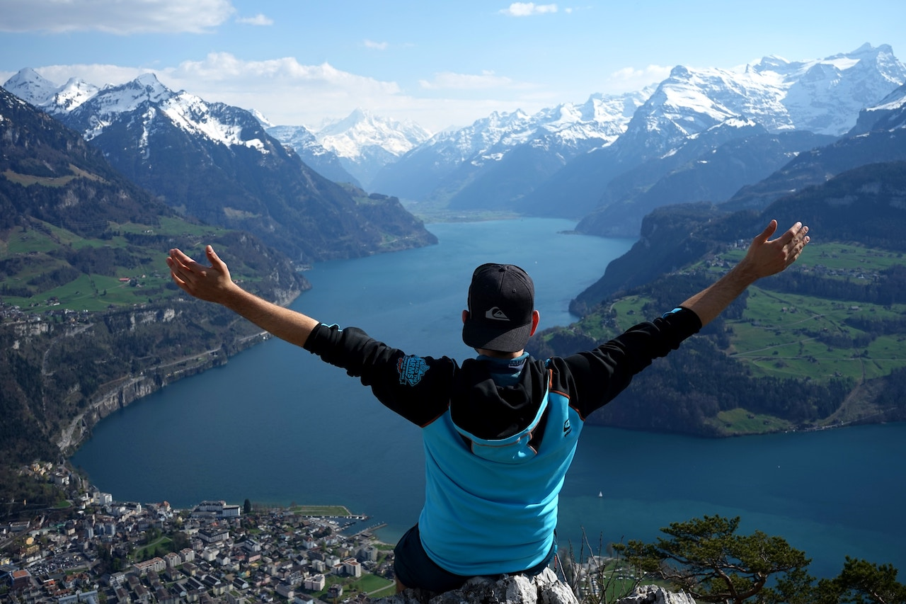 A man hiker conquering the mount Rigi in Switzerland