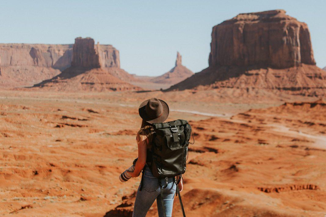 Female backpacker travelling in a desert