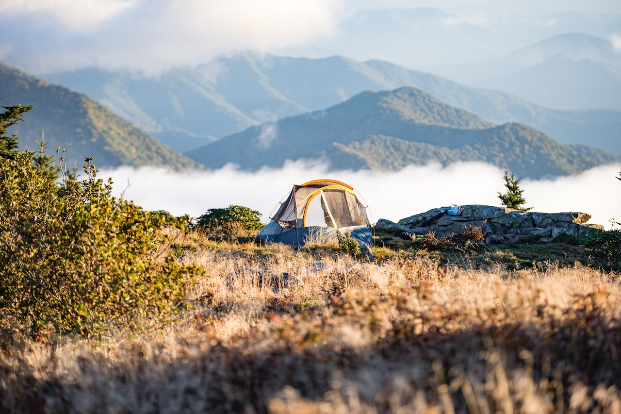 A camping tent set on top of a mountain