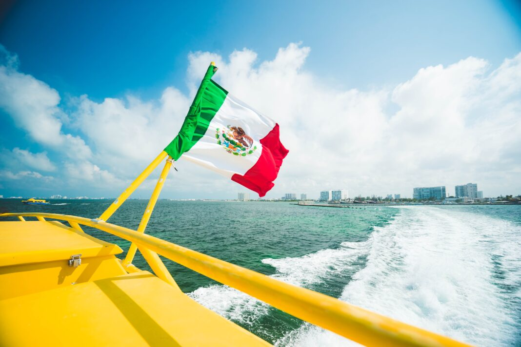 Mexican flag raised in the yellow boat.