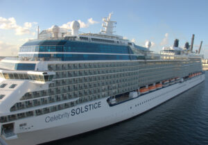 A white cruise ship with a label saying Celebrity SOLSCTICE.