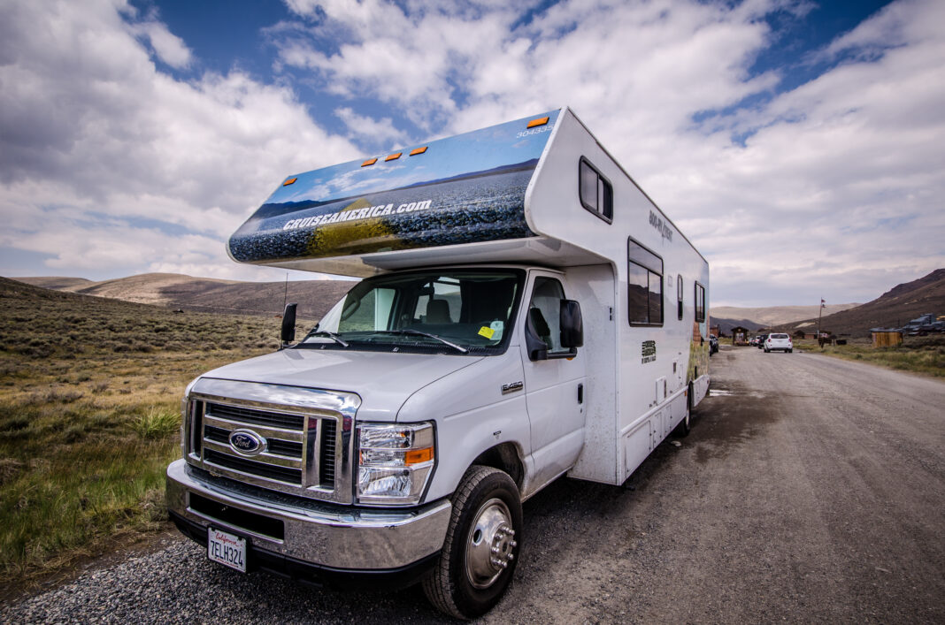 A Cruise America RV recreational vehicle is parked in Bodie Ghost Town. These cars are rental RVs for tourists, and popular in the Western United States