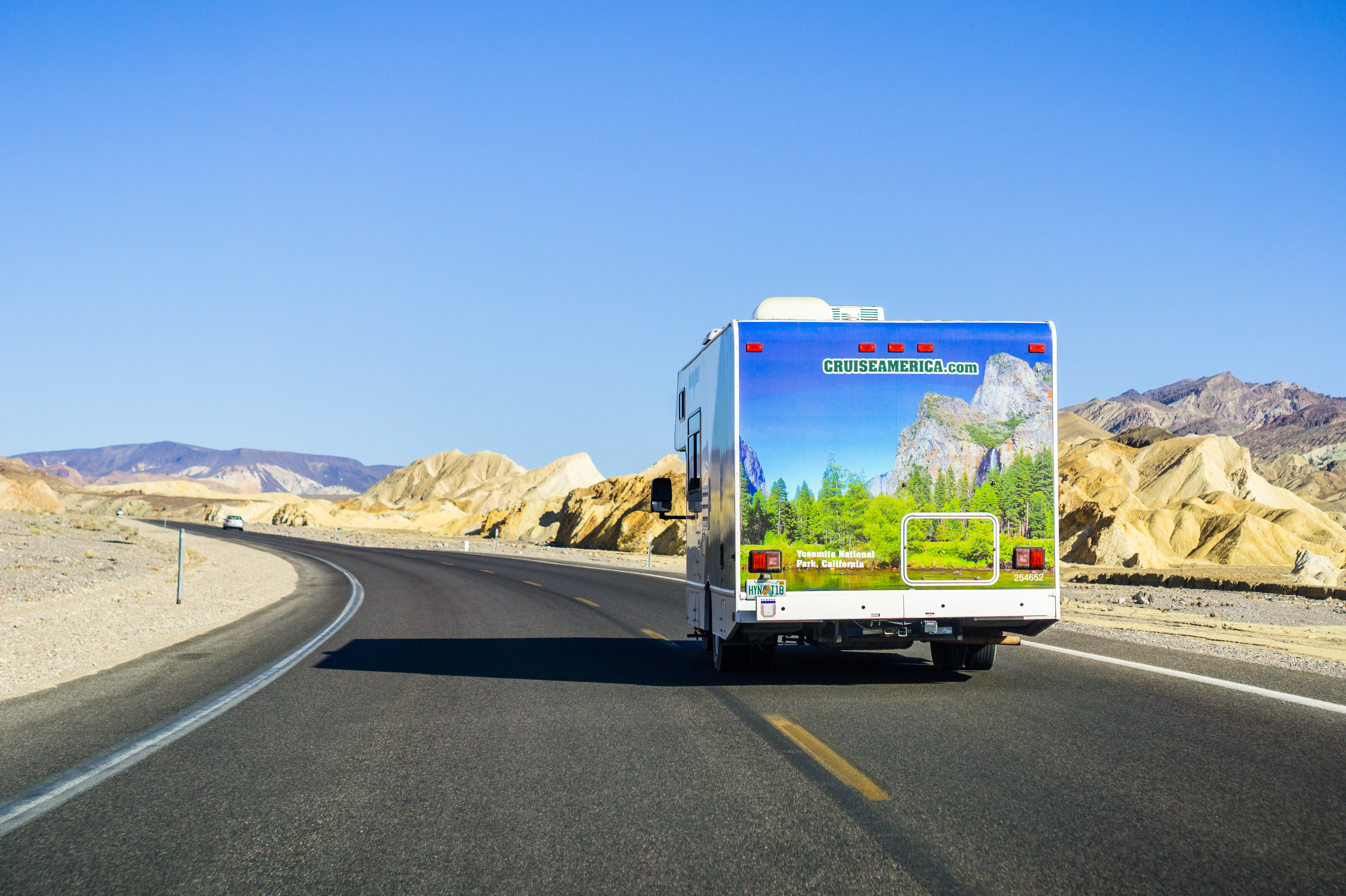 Cruise America RV camper traveling through Death Valley National Park
