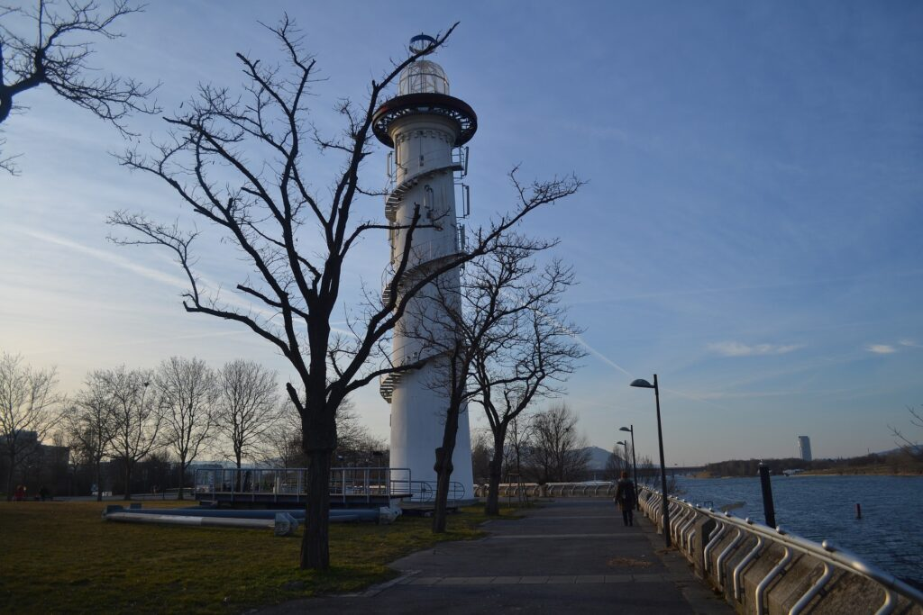 A beacon tower behind trees in Danube Island