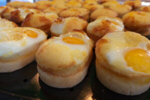 Steamed breads with sunny side-up on top.