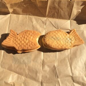 Two goldfish-shaped breads.