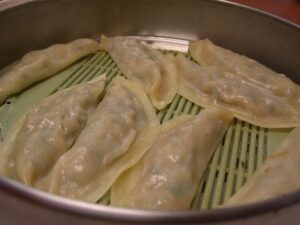 Korean dumplings or mandu inside a steamer.