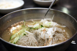 A bowl of naengmyeon or cold buckwheat noodles