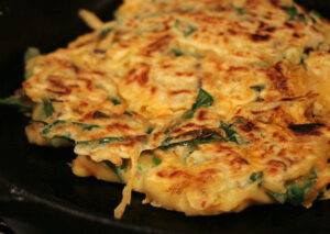 Korean pancakes stuffed with vegetables.