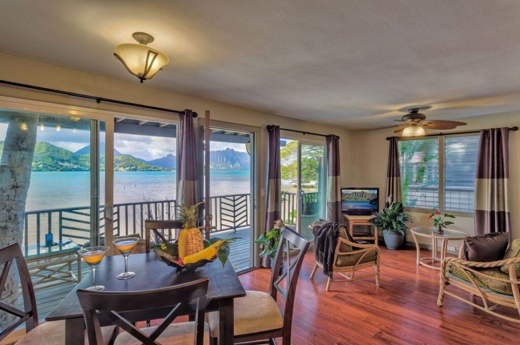 A lounge room with a waterfront view.