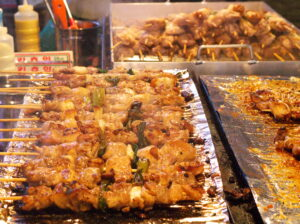 Spicy chicken skewers sold in streets of Seoul.