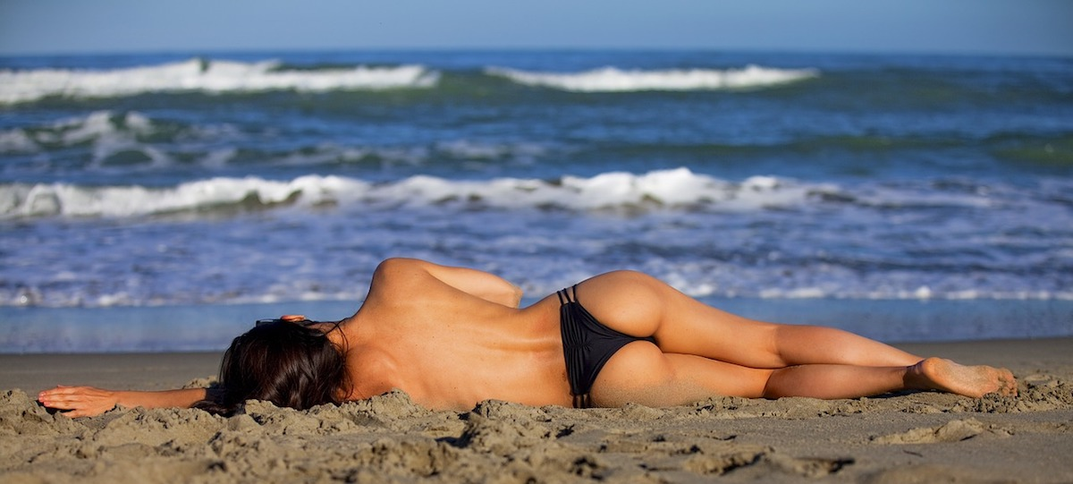 Woman sunbathing at the beach