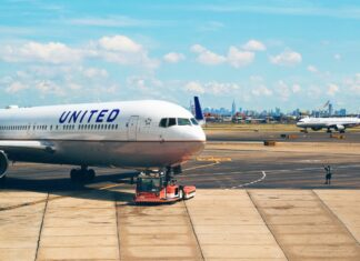 United airline jet plane boeing-777 on the airport runway