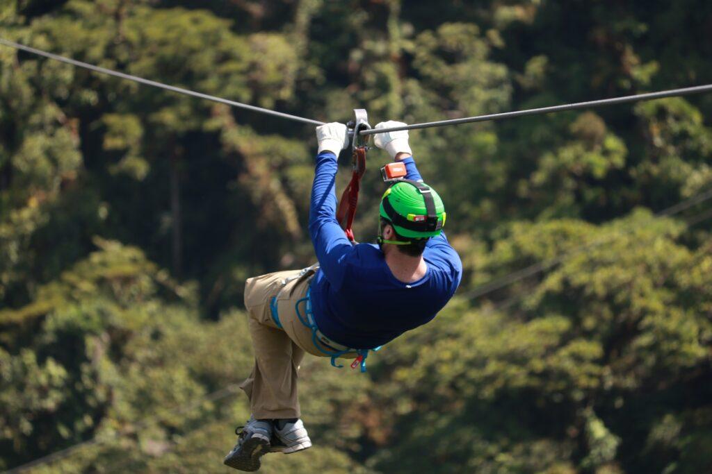 A guy riding a zipline