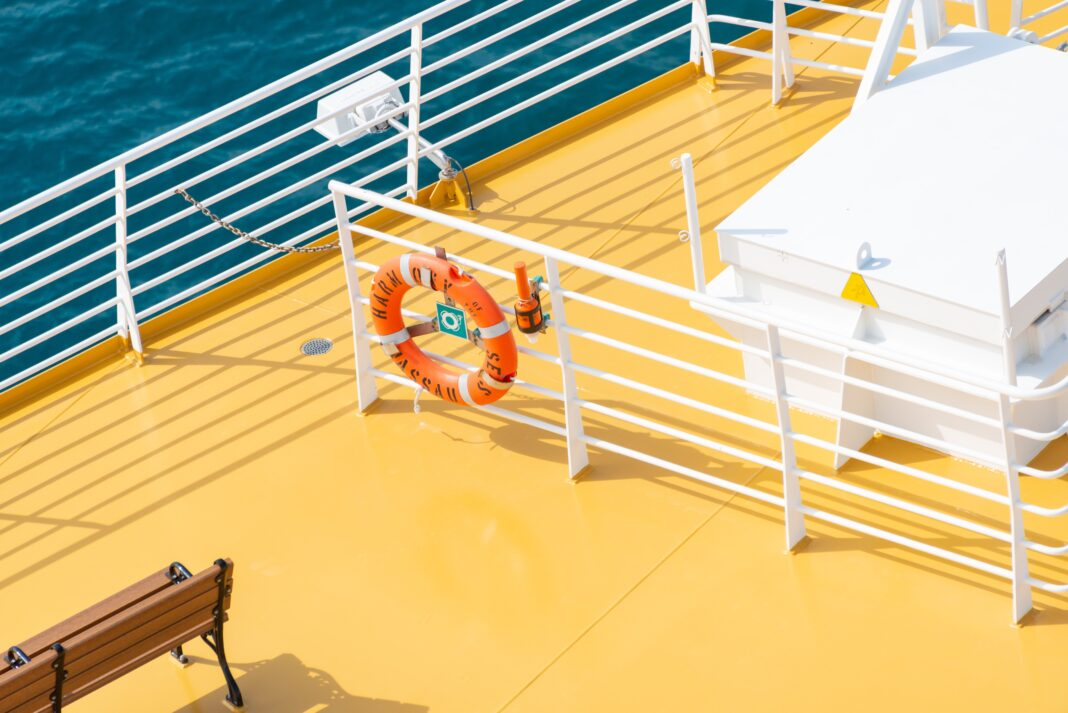 Overview of a cruise ship deck painted in white and yellow.