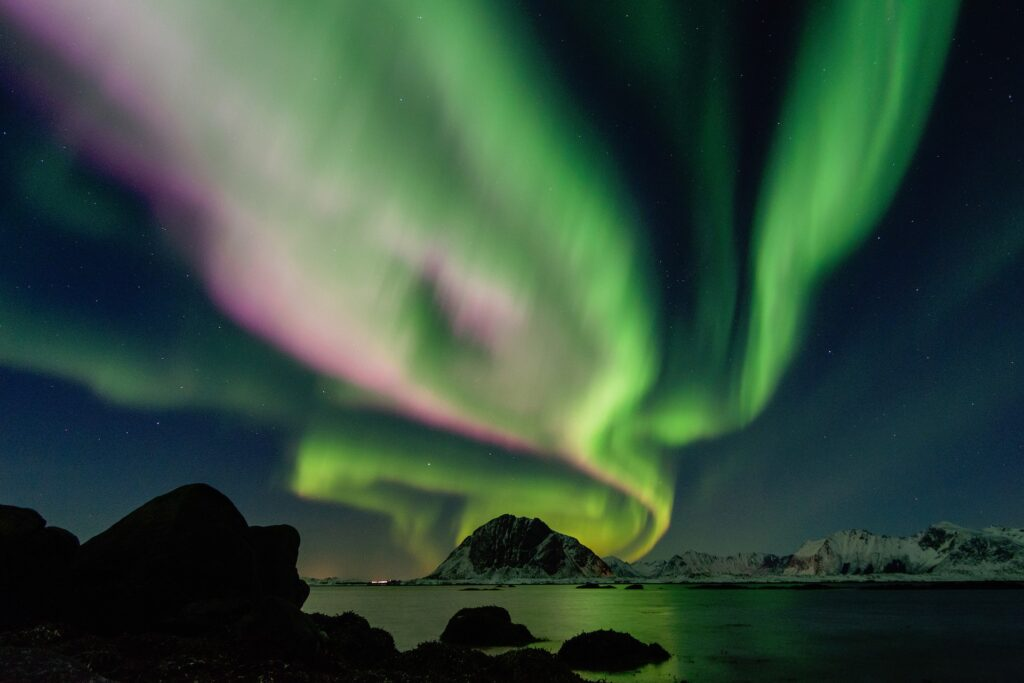 Northern lights above the sea and isles.