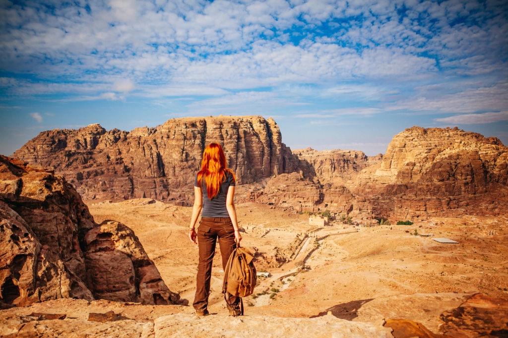 Female hiker hiking in Wadi Rum, Jordan