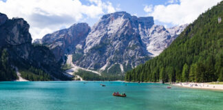 Hikers and travelers sailing boat in Lake braies, Dolomite, Italy.