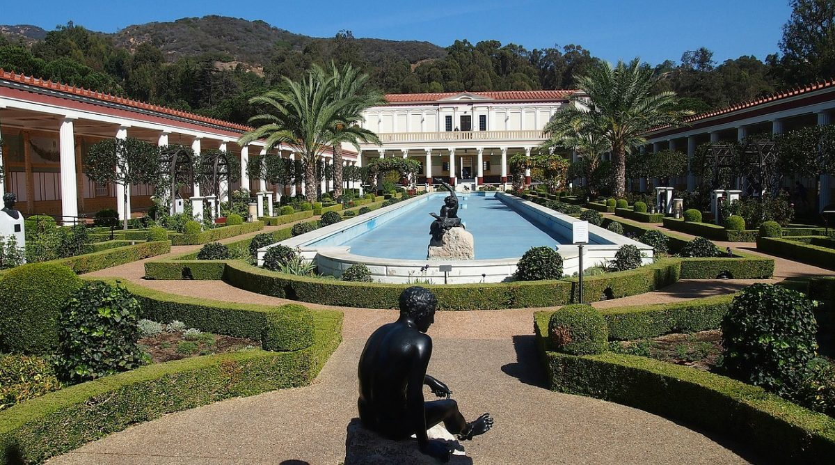 Panoramic view of the Getty Villa with fountains and statues