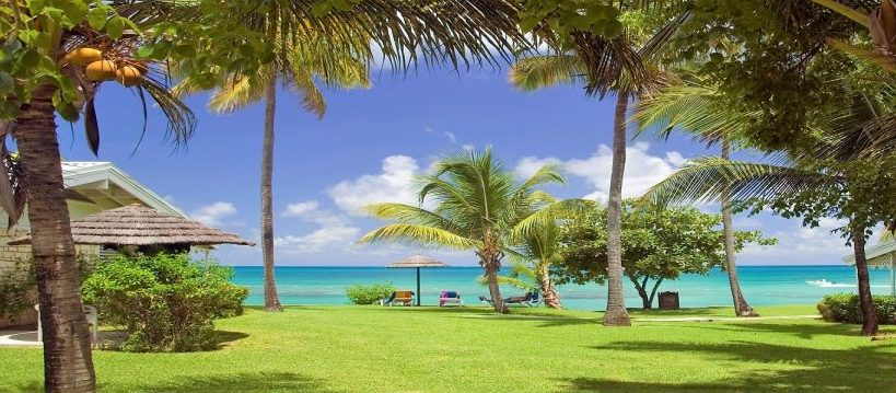 Beachfront view of the Hawksbill Antigua clothing optional resorts