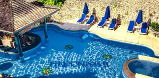 Pool of the Hedonism II Negril Jamaica on a sunny day