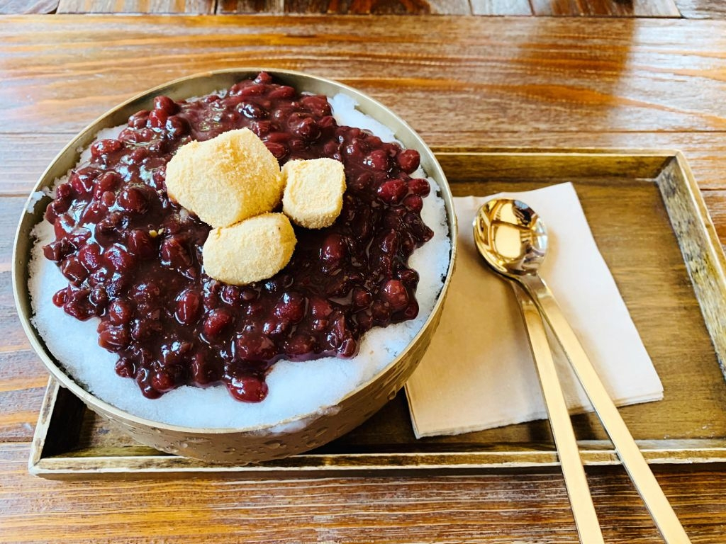 Korean mochi with red bean paste topped on a Korean shaved ice
