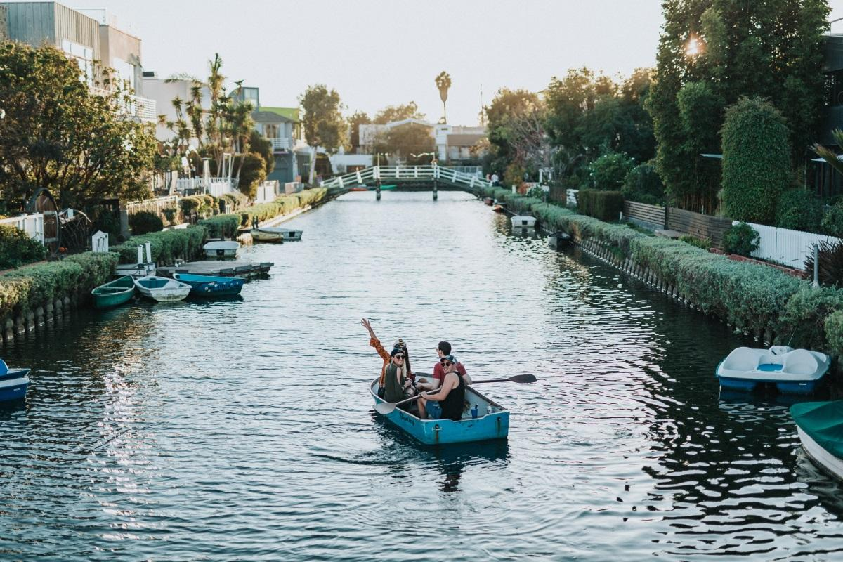 Friends kayaking in LA Venice Canals