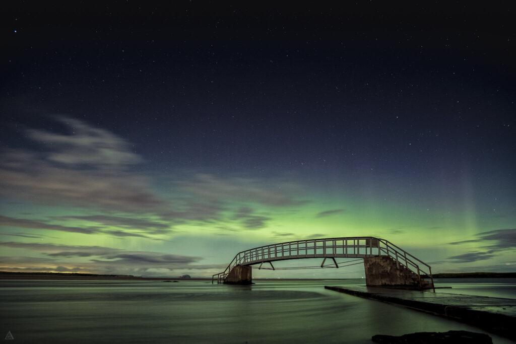 A bridge under the northern lights.