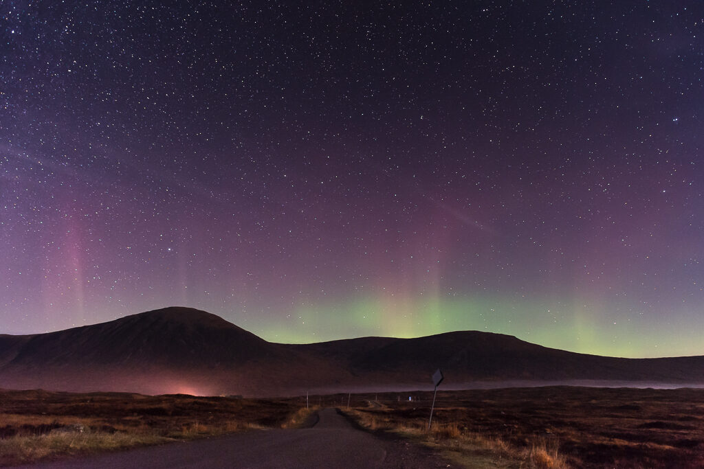 Norther lights over mountain ranges.