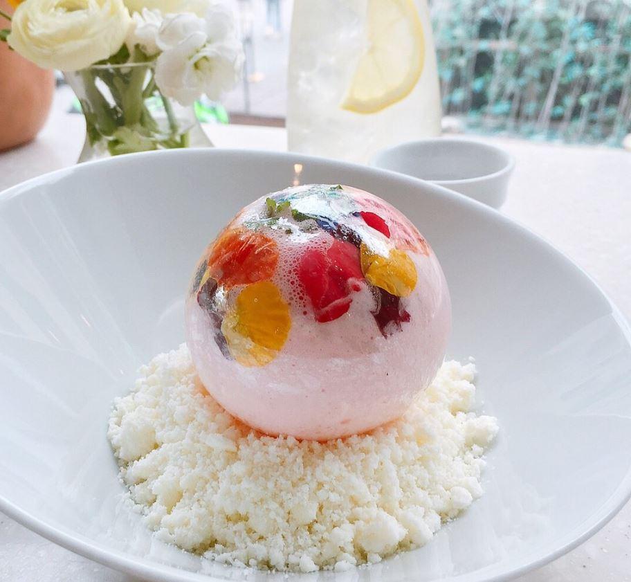A pink sugar ball in a white bowl.
