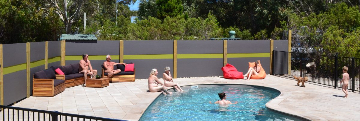 Nude tourist having a family activity near the pool in Sunland Holiday Village, Australia