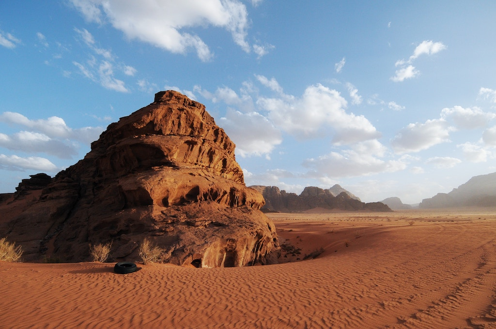 Wadi Rum panoramic landscape view with red sand desert during the day