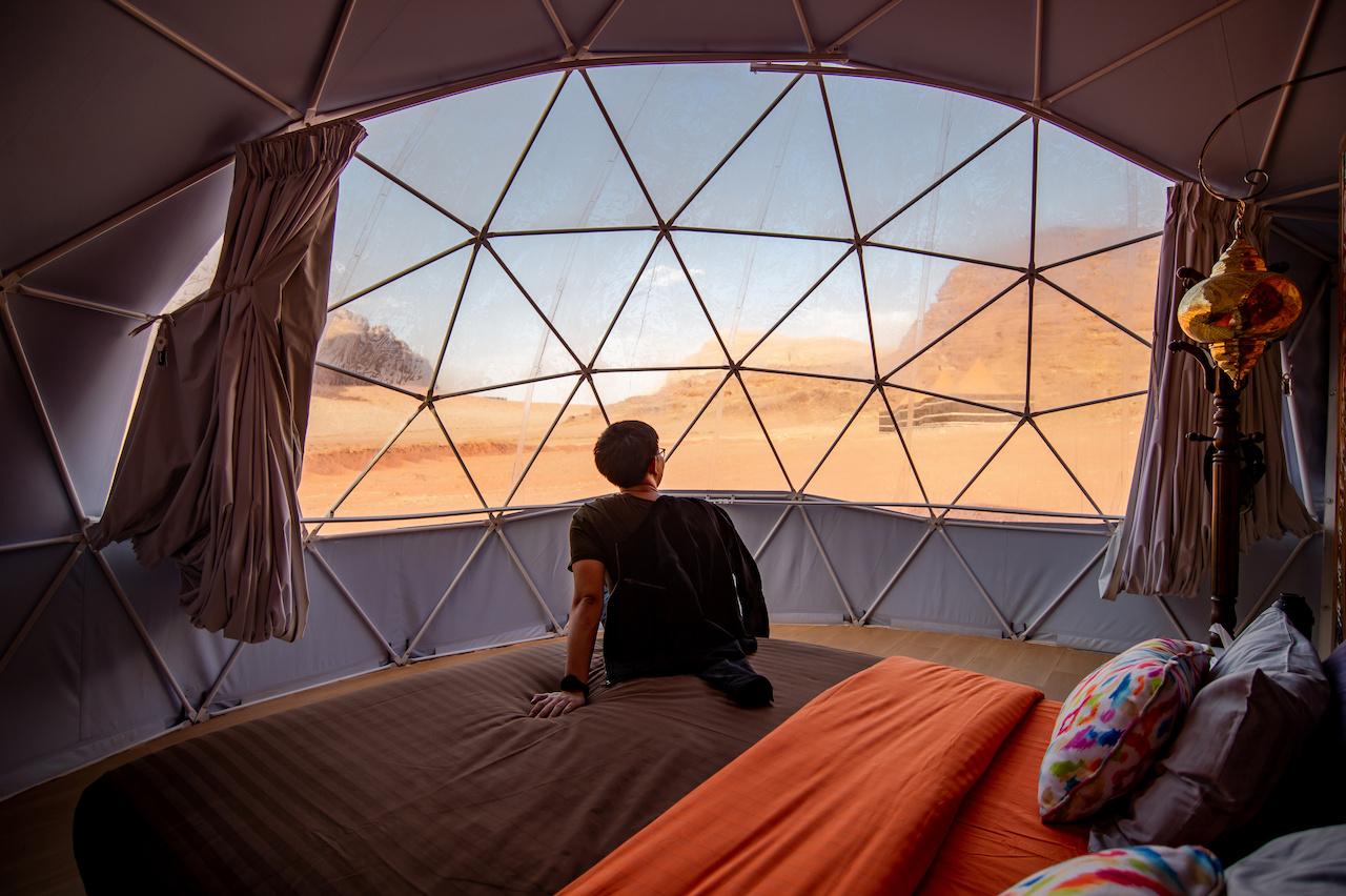 Tourist man in dome tent at Wadi Rum, Jordan