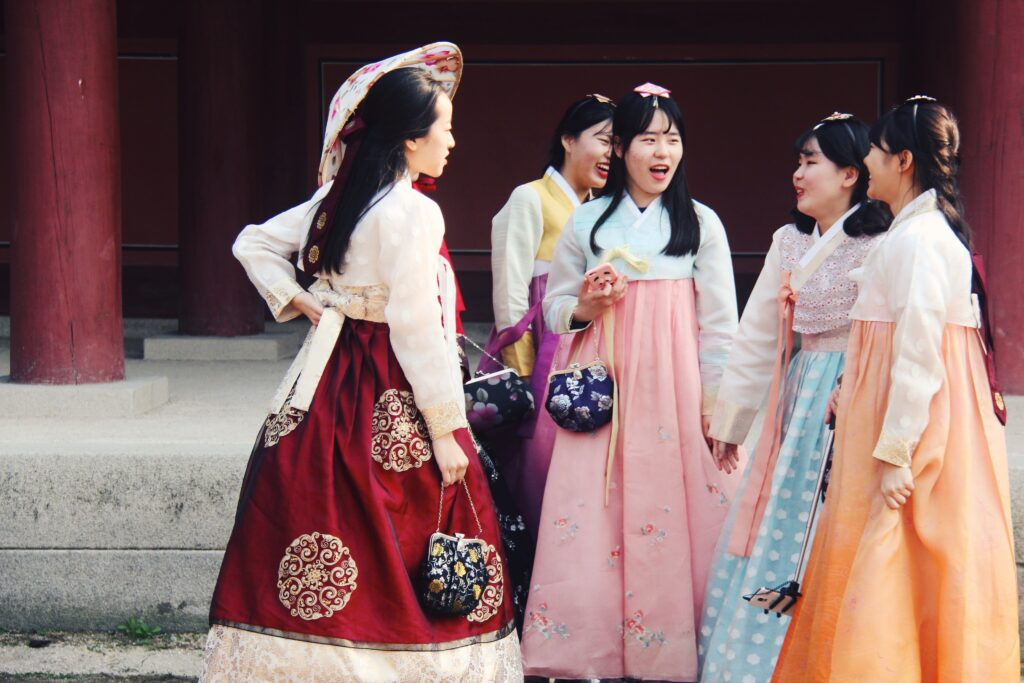 A group of girls wearing Hanbok, the traditional attire of Korea.