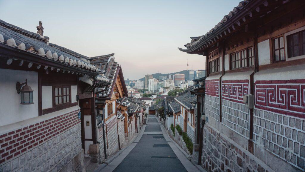 An empty street in a Hanok village, a traditional Korean neighborhood.