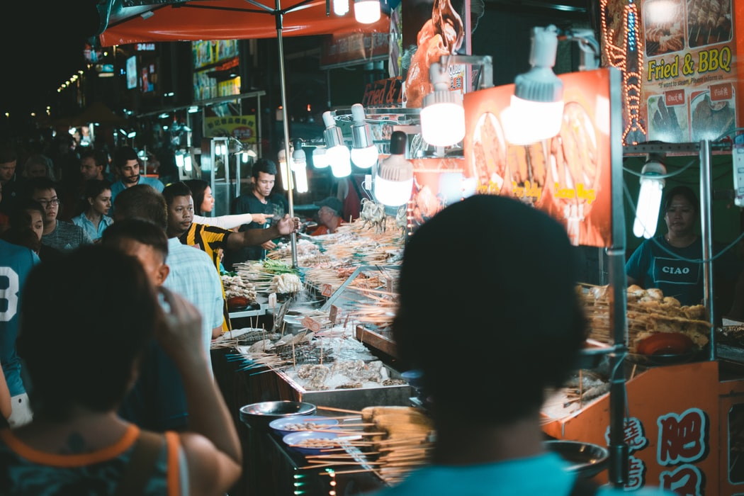 Street vendors at KL night market.