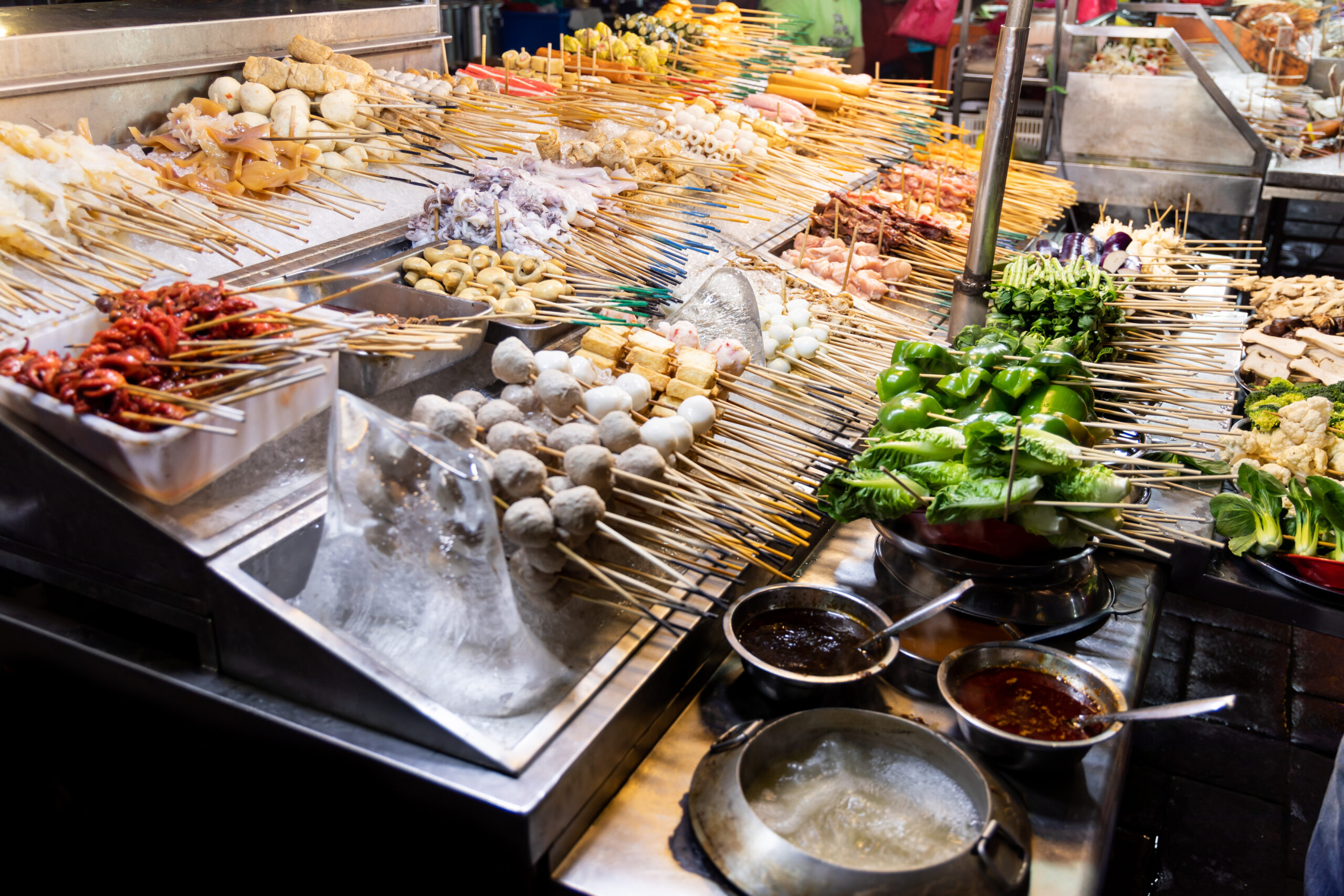 Array of popular local delicacy named lok lok at Jalan Alor, popular tourist destination in Kuala Lumpur, Malaysia