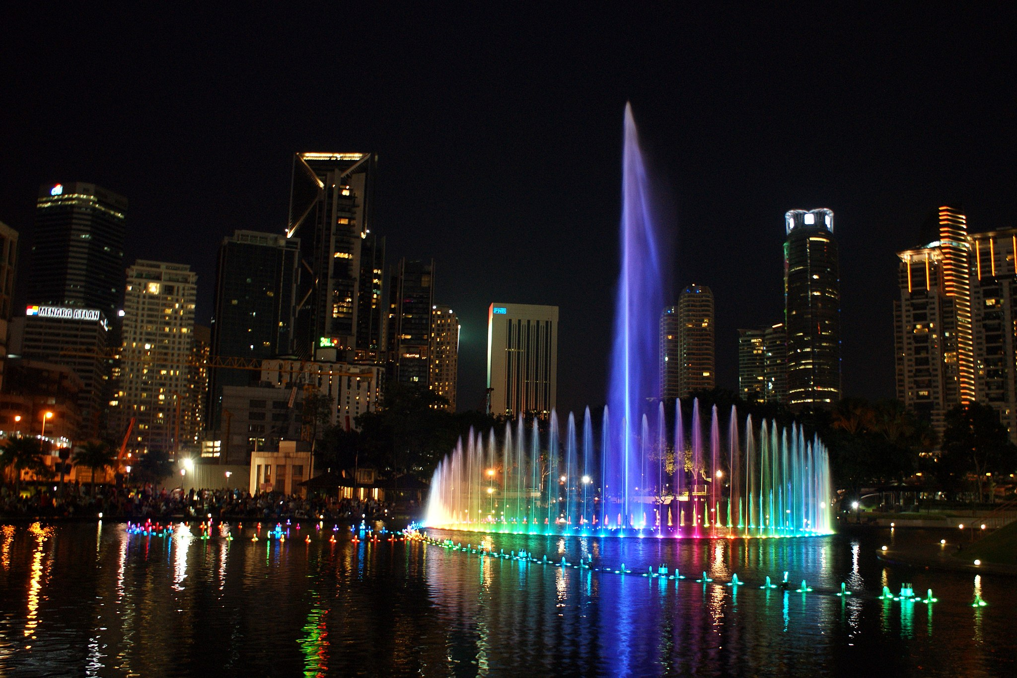 Light show at the Lake Symphony of KLCC Park during the night.