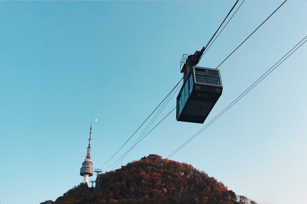A cable car approaching a tower.