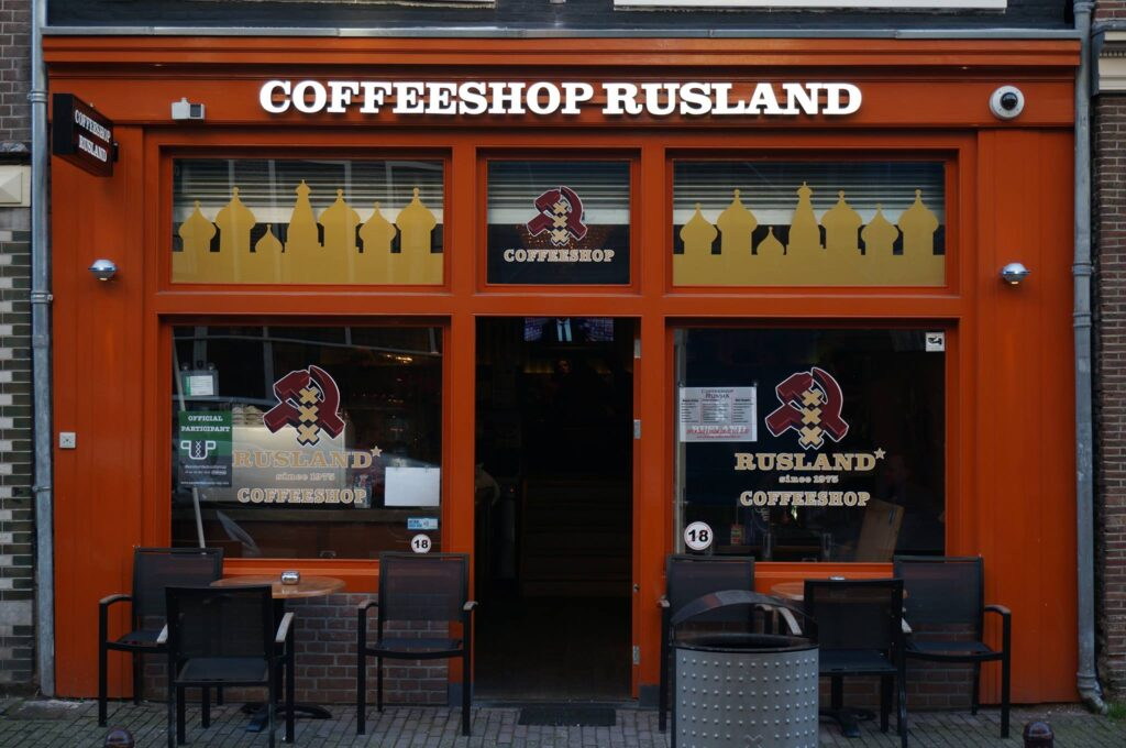 "A brown store front with a signage above that says ""Coffeeshop Rusland""."