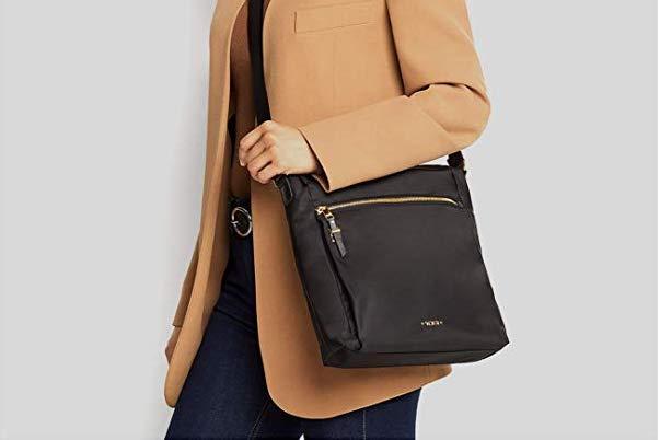 Leather Tumi Voyageur Crossbody Bag in black.