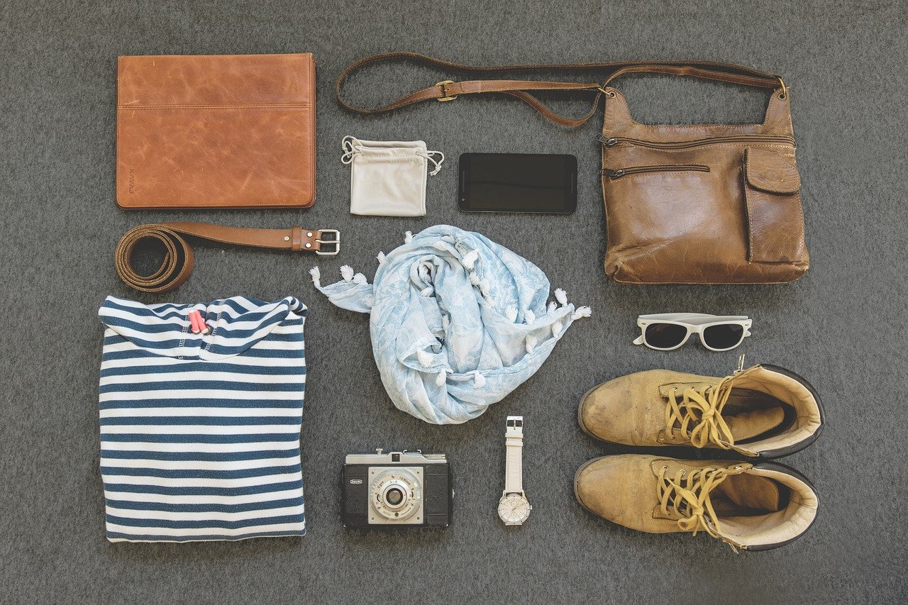 All travel essentials lay out on the floor