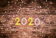 2020 sign on a wooden platform.